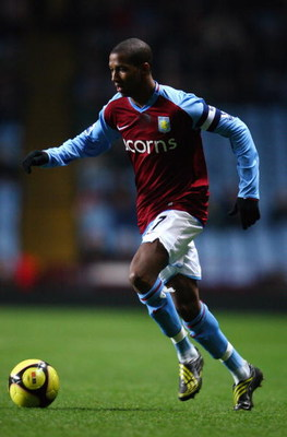 BIRMINGHAM, UNITED KINGDOM - FEBRUARY 04:  Ashley Young of Aston Villa runs with the ball during the F.A Cup sponsored by E.on 4th round replay match between Aston Villa and Doncaster Rovers at Villa Park on February 4, 2009 in Birmingham, England.  (Phot