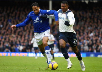 LIVERPOOL, UNITED KINGDOM - FEBRUARY 07:  Ariza Makukula of Bolton battles with Joleon Lescott of Everton during the Barclays Premier League match between Everton and Bolton at Goodison Park on February 7, 2009 in Liverpool, England.  (Photo by Jamie McDo