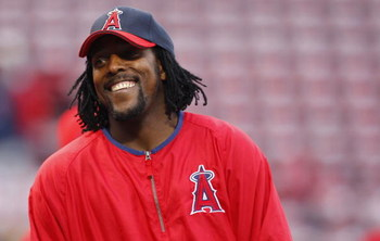 BOSTON - OCTOBER 5: Vladimir Guerrero #27 of the Los Angeles Angels of Anaheim enjoys a laugh before game three of the American League Division Series against the Boston Red Sox at Fenway Park on October 5, 2008 in Boston, Massachusetts. (Photo by Jim Rog