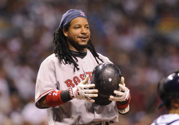 ST PETERSBURG, FL - July 2: Designated hitter Manny Ramirez #24 of the Boston Red Sox smiles after ducking from an inside pitch  against the Tampa Bay Rays July 2, 2008 at Tropicana Field in St. Petersburg, Florida.  (Photo by Al Messerschmidt/Getty Image