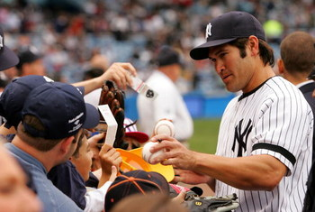 NEW YORK - APRIL 28:  Johnny Damon #18 of the New York Yankees signs autographs for fans before the game against the Boston Red Sox at Yankee Stadium on April 28, 2007 in the Bronx borough of New York City.  (Photo by Chris Trotman/Getty Images)