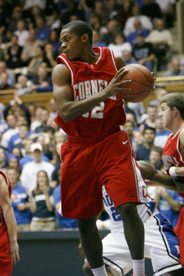 DURHAM - JANUARY 6:  Louis  Dale #12 of Cornell Big Red looks to move the ball during the college basketball game against the Duke Blue Devils at Cameron Indoor Stadium on January 6, 2008 in Durham, North Carolina. (Photo by Kevin C. Cox/Getty Images)