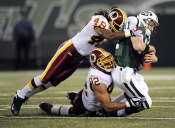 EAST RUTHERFORD, NJ - AUGUST 16:  Kellen Clemens #11 of the New York Jets  is sacked by Chris Horton #48 and Antwaan Randle El #82 of the Washington Redskins in a pre-season NFL game at Giants Stadium, August 16, 2008 in East Rutherford, New Jersey.  (Pho