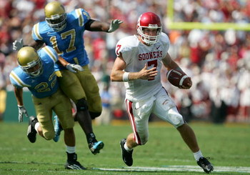 PASADENA, CA - SEPTEMBER 17:  Rhett Bomar #7 of the Oklahoma Sooners is chased down by Michael Norris #22 and Justin Hickman #17 of the UCLA Bruins during their game on September 17, 2005 at the Rose Bowl in Pasadena, California.  (Photo by Jeff Gross/Get
