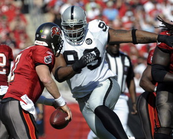 TAMPA, FL - DECEMBER 28: Defensive tackle Tommy Kelly #93 of the Oakland Raiders rushes quarterback Jeff Garcia #7 of the Tampa Bay Buccaneers at Raymond James Stadium on December 28, 2008 in Tampa, Florida.  (Photo by Al Messerschmidt/Getty Images)