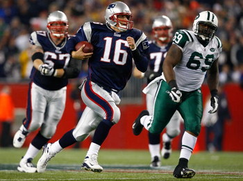 FOXBORO, MA - NOVEMBER 13:  Matt Cassel #16 of the New England Patriots is chased by C.J. Mosley #69 of the New York Jets at Gillette Stadium on November 13, 2008 in Foxboro, Massachusetts. The Jets won 34-31 in overtime. (Photo by Jim Rogash/Getty Images