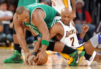 LOS ANGELES, CA - DECEMBER 25:   Glen Davis #11 of the Boston Celtics and Lamar Odom #7 of the Los Angeles Lakers battle for possession of the ball at Staples Center on December 25, 2008 in Los Angeles, California.  The Lakers defeated the Celtics 92-83.