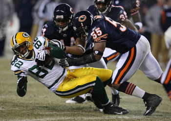 CHICAGO - DECEMBER 22: Lance Briggs #55 and Kevin Payne #44 of the Chicago Bears bring down Ruvell Martin #82 of the Green Bay Packers on December 22, 2008 at Soldier Field in Chicago, Illinois. (Photo by Jonathan Daniel/Getty Images)