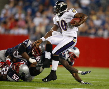 FOXBORO, MA - AUGUST 7:  Troy Smith #10 of the Baltimore Ravens is sacked by Eric Alexander #52 and Kenny Smith #95 of the New England Patriots during a preseason game at Gillette Stadium on August 7, 2008 in Foxboro, Massachusetts. (Photo by Jim Rogash/G