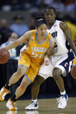 ATLANTA - APRIL 8:  Kara Lawson #20 of the University of Tennessee Lady Volunteers drives around Ashley Battle #22 of Connecticut Huskies during the NCAA Women's Championship game at the Georgia Dome on April 8, 2003 in Atlanta, Georgia. Connecticut beat
