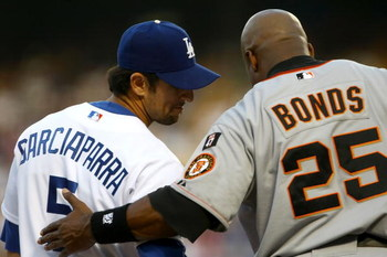 LOS ANGELES, CA - AUGUST 02:  Nomar Garciaparra #5 of the Los Angeles Dodgers talks with Barry Bonds #25 of the San Francisco Giants at third base in the first inning at Dodger Stadium on August 2, 2007 in Los Angeles, California.  (Photo by Stephen Dunn/