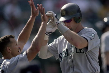30 Sep 2000:  Jay Buhner #19 of the Seattle Mariners high fives Alex Rodriguez #3 as he moves to the dugout during the game against the Anaheim Angels at Edison Field in Anaheim, California. The Mariners defeated the Angels 21-9.Mandatory Credit: Jeff Gro