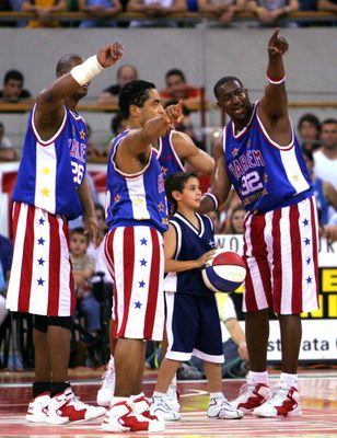 MADRID, SPAIN - JUNE 10:  Harlem Globetrotters players play with a boy during their match against the New York Nationals on June 10, 2005 at the Vistalegre Stadium in Madrid, Spain.  (Photo by Denis Doyle/Getty Images)