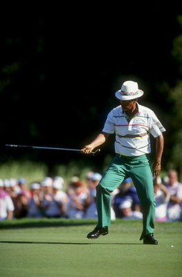 Nov 1990: Chi Chi Rodriguez gabbs his putter after making the putt during the Seniors PGA Tour in Rancho Park, California. Mandatory Credit: Stephen Wade  /Allsport