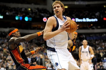 DALLAS - JANUARY: Forward Dirk Nowitzki #41 of the Dallas Mavericks moves the ball against Stephen Jackson #1 of the Golden State Warriors on January 28, 2008 at American Airlines Center in Dallas, Texas. NOTE TO USER: User expressly acknowledges and agre