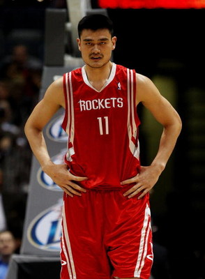 MILWAUKEE - FEBRUARY 09: Yao Ming #11 of the Houston Rockets watches as a teammate shoots a free-throw against the Milwaukee Bucks on February 9, 2009 at the Bradley Center in Milwaukee, Wisconsin. The Bucks defeated the Rockets 124-112. NOTE TO USER: Use