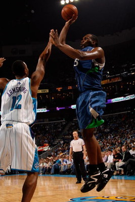 NEW ORLEANS - FEBRUARY 08:  Al Jefferson #25 of the Minnesota Timberwolves  makes a shot over Hilton Armstrong #12 of the New Orleans Hornets on February 8, 2009 in New Orleans, Louisiana.  NOTE TO USER: User expressly acknowledges and agrees that, by dow
