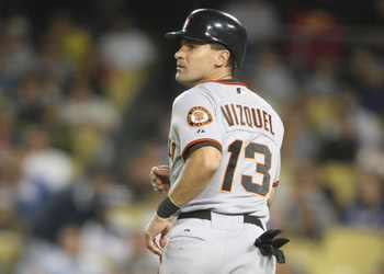 LOS ANGELES, CA - SEPTEMBER 19:   Omar Vizquel #13 of the San Francisco Giants looks on as he runs home to score in the fifth inning against the Los Angeles Dodgers at Dodger Stadium on September 19, 2008 in Los Angeles, California.  (Photo by Lisa Blumen