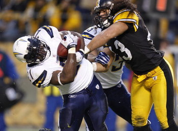PITTSBURGH - NOVEMBER 16:  LaDanian Tomlinson #21 of the San Diego Chargers scores a first quarter touchdown while taking a hit from Troy Polamalu #43 of the Pittsburgh Steelers during the second quarter on November 16, 2008 at Heinz Field in Pittsburgh,