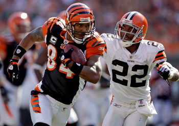 CINCINNATI - SEPTEMBER 28:  T.J. Houshmandzadeh #84 of the Cincinnati Bengals runs with the ball while defended by Brandon McDonald #22 of the Cleveland Browns during the NFL game on September 28, 2008 at Paul Brown Stadium in Cincinnati, Ohio.  (Photo by