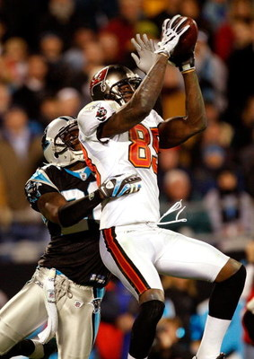 CHARLOTTE, NC - DECEMBER 08:  Antonio Bryant #89 of the Tampa Bay Buccaneers catches a pass over Chris Gamble #20 of the Carolina Panthers at Bank of America Stadium on December 8, 2008 in Charlotte, North Carolina.  (Photo by Streeter Lecka/Getty Images)