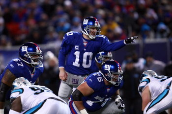 EAST RUTHERFORD, NJ - DECEMBER 21:  Quarterback Eli Manning #10 of the New York Giants signals before the snap against the Carolina Panthers on December 21, 2008 at Giants Stadium in East Rutherford, New Jersey.  (Photo by Chris McGrath/Getty Images)