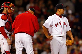 BOSTON - OCTOBER 16:  Starting pitcher Daisuke Matsuzaka #18 of the Boston Red Sox reacts after being removed against the Tampa Bay Rays in game five of the American League Championship Series during the 2008 MLB playoffs at Fenway Park on October 16, 200
