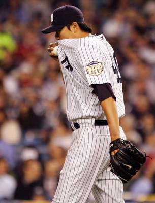 NEW YORK - MAY 07:  Chien-Ming Wang #40 of the New York Yankees reacts in the fifth inning against the Cleveland Indians on May 7, 2008 at Yankee Stadium in the Bronx borough of New York City.  (Photo by Jim McIsaac/Getty Images)*** Local Caption *** Chie