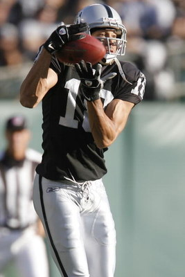 OAKLAND, CA - AUGUST 23:  Wide receiver Drew Carter #18 of the Oakland Raiders catches a pass against the Arizona Cardinals on August 23, 2008 at the McAfee Coliseum in Oakland, California.  (Photo by Greg Trott/Getty Images)