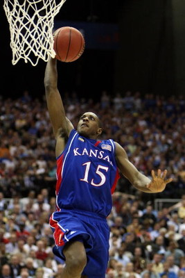 SAN ANTONIO - APRIL 05:  Mario Chalmers #15 of the Kansas Jayhawks goes up for a dunk while taking on the North Carolina Tar Heels during the National Semifinal game of the NCAA Men's Final Four at the Alamodome on April 5, 2008 in San Antonio, Texas.  (P
