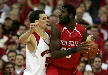 MADISON, WI - JANUARY 09:  Greg Oden #20 of the Ohio State Buckeyes looks to pass the ball out of the post against Jason Chappell #5 of the Wisconsin Badgers during their Big Ten Conference game on January 9, 2007 at the Kohl Center in Madison, Wisconsin.