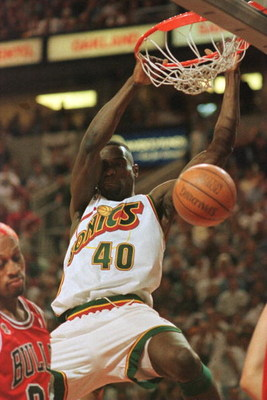 14 Jun 1996: Shawn Kemp #40 of the Seattle Supersonics dunks the ball over Dennis Rodman of the Chicago Bulls during the first quarter of game five of the NBA Finals at Key Arena in Seattle, Washington.