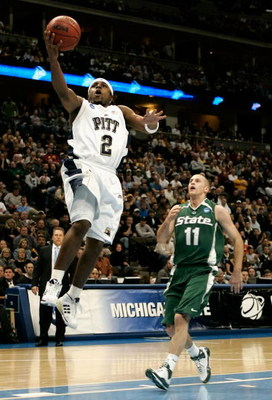 DENVER - MARCH 22:  Levance Fields #2 of the Pittsburgh Panthers lays up a shot past Drew Neitzel #11 of the Michigan State Spartans during the second round game of the South Regional as part of the 2008 NCAA Men's Basketball Tournament at Pepsi Center Ma