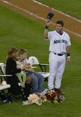 SEATTLE, WA - OCTOBER 2:  Edgar Martinez #11 of the Seattle Mariners (and his family) acknowledges the crowd during a post game ceremony honoring his 18 year career with the Mariners on October 2, 2004 at Safeco Field in Seattle, Washington.  (Photo by Li