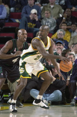 SEATTLE - NOVEMBER 27:  Point guard Gary Payton #20 of the Seattle SuperSonics posts up guard Chauncey Billups #4 of the Minnesota Timberwolves during the NBA game at Key Arena in Seattle, Washington on November 27, 2001.  The Sonics won 112-102.  NOTE TO