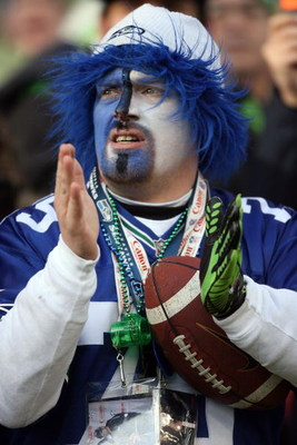SEATTLE - JANUARY 05:  A Seattle Seahawks fan cheers on his team during the game against the Washington Redskins during the NFC Wild Card game at Qwest Field on January 5, 2008 in Seattle, Washington. The Seahawks defeated the Redskins 35-14.  (Photo by O
