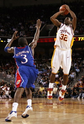 LOS ANGELES, CA - DECEMBER 02:  O.J. Mayo #32 of the USC Trojans puts up a shot over Russell Robinson #3 of the Kansas Jayhawks during the first half of the game at Galen Center on December 2, 2007 in Los Angeles, California.  (Photo by Christian Petersen