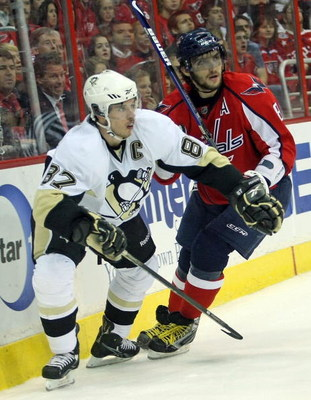 WASHINGTON - MAY 13:  Alex Ovechkin #8 of the Washington Capitals skates against Sidney Crosby #87 of the Pittsburgh Penguins during Game Seven of the Eastern Conference Semifinal  Round of the 2009 Stanley Cup Playoffs at Verizon Center on May 13, 2009 i