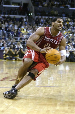 LOS ANGELES - APRIL 17:  Jim Jackson #21 of the Houston Rockets slips with the ball during Game one of the Western Conference Quarterfinals against the Los Angeles Lakers during the 2004 NBA Playoffs at Staples Center on April 17, 2004 in Los Angeles, Cal