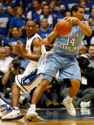DURHAM, NC - FEBRUARY 11:  Danny Green #14 of the North Carolina Tar Heels dribbles past Nolan Smith #2 of the Duke Blue Devils during the game on February 11, 2009 at Cameron Indoor Stadium in Durham, North Carolina.  (Photo by Kevin Cox/Getty Images)