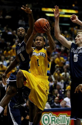MILWAUKEE - JANUARY 31: Dominic James #1 of the Marquette Golden Eagles goes up for a shot against DaJuan Summers #3 and Nikita Mescheriakov #5 of the Georgetown Hoyas on January 31, 2009 at the Bradley Center in Milwaukee, Wisconsin. Marquette defeated G