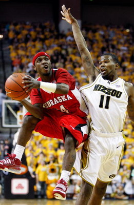 COLUMBIA, MO - FEBRUARY 14:  Cookie Miller #24 of the Nebraska Cornhuskers shoots as Zaire Taylor #11 of the Missouri Tigers defends during the game on February 14, 2009 at Mizzou Arena in Columbia, Missouri.  (Photo by Jamie Squire/Getty Images)