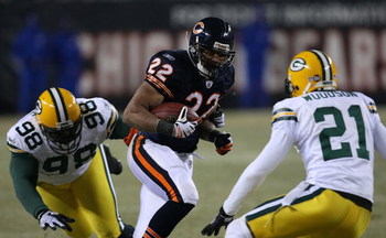 CHICAGO - DECEMBER 22: Matt Forte #22 of the Chicago Bears runs for yardage against Alfred Malone #98 and Charles Woodson #21 of the Green Bay Packers on December 22, 2008 at Soldier Field in Chicago, Illinois. The Bears defeated the Packers 20-17 in over