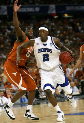 HOUSTON - MARCH 30:  Robert Dozier #2 of the Memphis Tigers drives the ball past Damion James #5 of the Texas Longhorns during the fourth round game of the South Regional as part of 2008 NCAA Men's Basketball Tournament at Reliant Stadium on March 30, 200