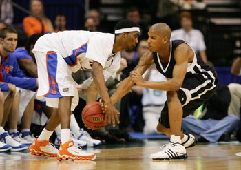 JACKSONVILLE, FL - MARCH 18:  Avery Smith #3 of the Wisconsin-Milwaukee Panthers defends against Corey Brewer #2 of the Florida Gators during round two of the NCAA National Championship on March 18, 2006 at the Veterans Memorial Arena in Jacksonville, Flo