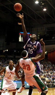 DAYTON, OH - MARCH 13:  Benson Egemonye #15 of the  Niagara Purple Eagles tries to get a shot off over Akini Adkins #33 of the Florida A&M Rattlers during the opening round of the Men's NCAA Tournament on March 13, 2007 at the University of Dayton Arena i