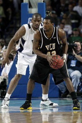 BUFFALO, NY - MARCH 17:  Sam Young #23 of the Pittsburgh Panthers defends T.J. Gwynn #42 of the Virginia Commonwealth Rams during round two of the NCAA Men's Basketball Tournament at HSBC Arena on March 17, 2007 in Buffalo, New York.  (Photo by Rick Stewa