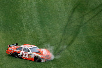 DAYTONA BEACH, FL - FEBRUARY 15: Joey Logano, driver of the #20 Home Depot Toyota, crashes during the NASCAR Sprint Cup Series Daytona 500 at Daytona International Speedway on February 15, 2009 in Daytona Beach, Florida.  (Photo by Matthew Stockman/Getty