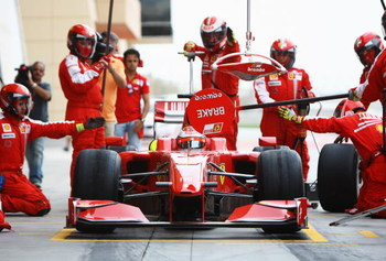 SAKHIR, BAHRAIN - FEBRUARY 17:  Kimi Raikkonen of Finland and Ferrari practices a pitstop during Formula One testing ahead of the 2009 Formula One season at the Bahrain International Circuit on February 17, 2009 in Sakhir, Bahrain.  (Photo by Paul Gilham/