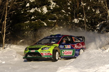 HAMAR, NORWAY - FEBRUARY 14:  Mikko Hirvonen and Jarmo Lehtinen of BP Ford Abu Dhabi WRT, Ford Focus RS in action during Leg 2 of Rally Norway 2009 on February 14, 2009 in Hamar, Norway.  (Photo by Reporter Images/Getty Images)